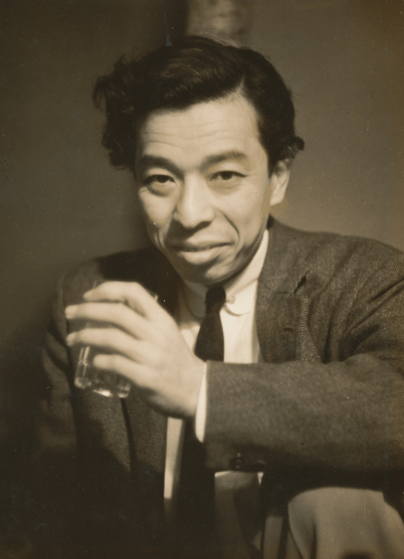 Kensuke Ishizu in Ōsaka during the early years of VAN Jacket, 1955.