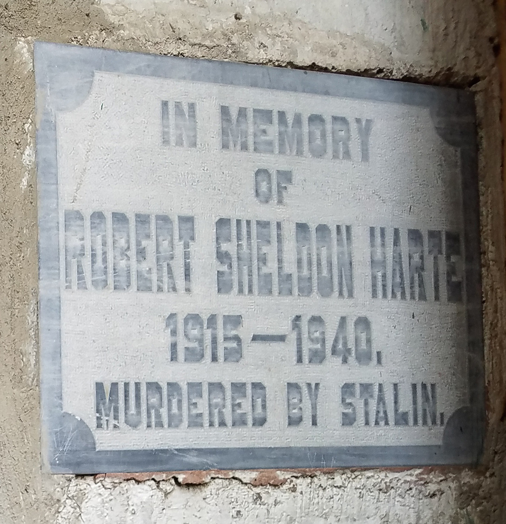Photograph of a plaque commemorating Sheldon Robert Harte—with his first and middle names transposed—next to the guard post where he stood duty one night in May 1940 when Stalinists attacked Leon Trotsky's compound, 2018, by Julia Harte.
