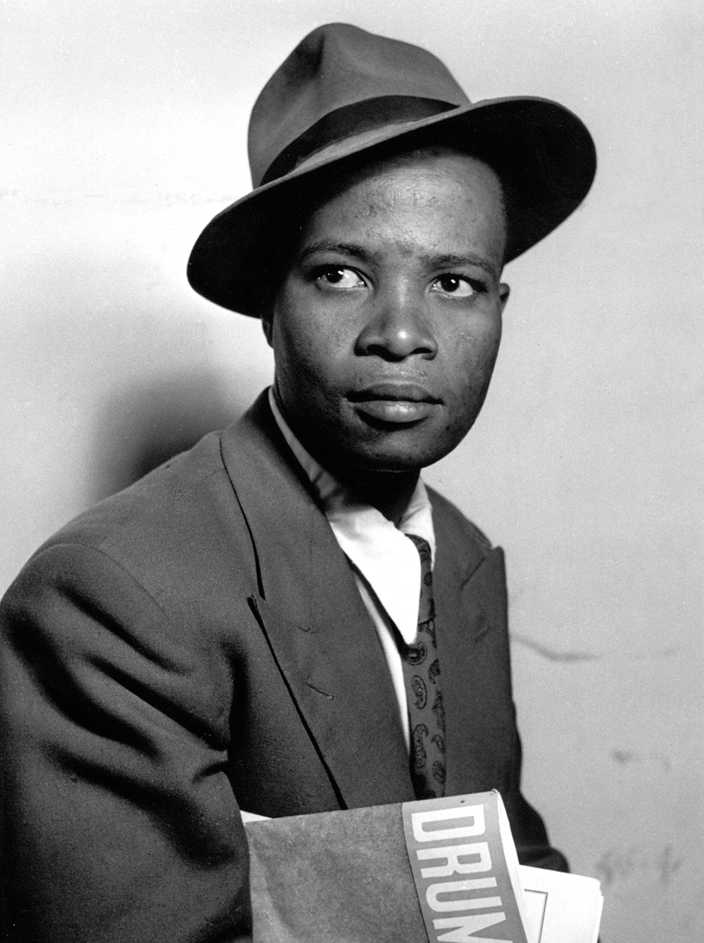 Henry Nxumalo as Mr. Drum, 1951. Photograph by Jürgen Schadeberg, jurgenschadeberg . com.