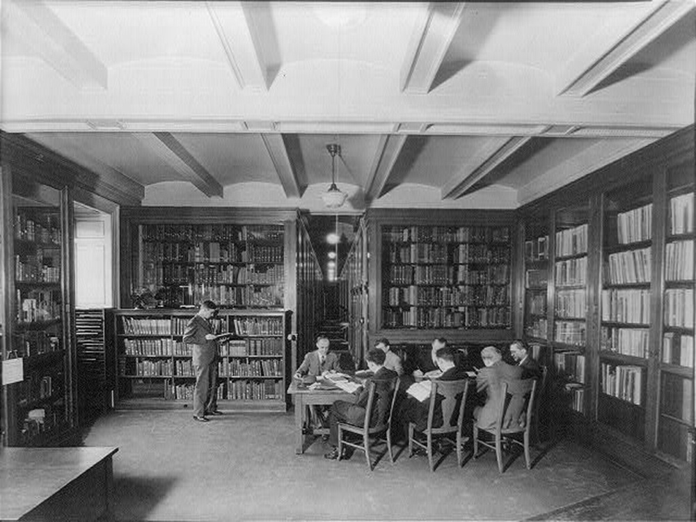 Men reading in a book-lined room at the Library of Congress, c. 1920. The Library of Congress, Prints and Photographs.