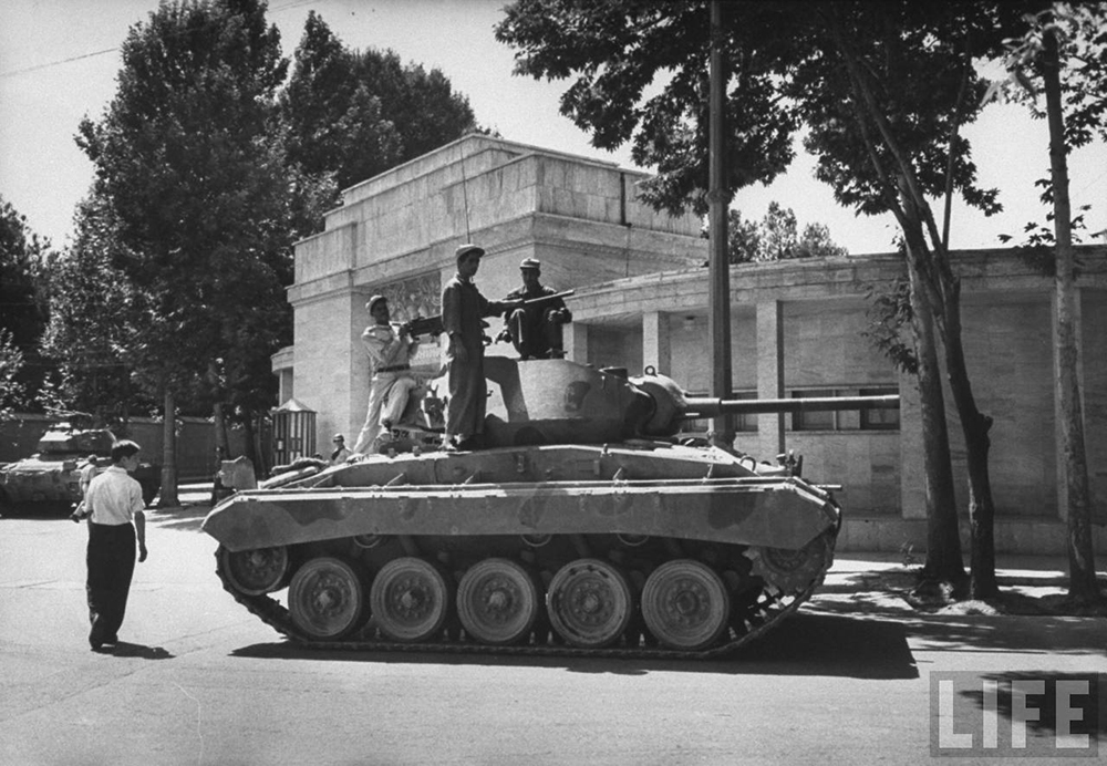 Tanks lining the streets during Shah Reza Pahlevi's return home, 1953. Photograph by Carl Mydan / Life Magazine.