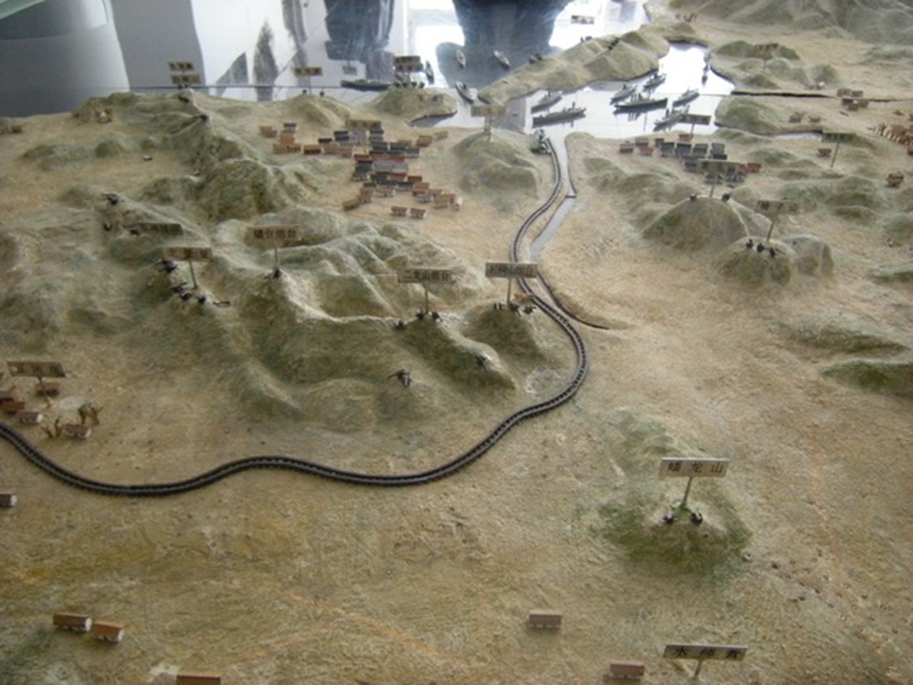 A relief map and model of Port Arthur that shows the extent to which the city and harbor were natural protectorates for the Russian fleet in 1904. Photograph by Matthew Stevenson.
