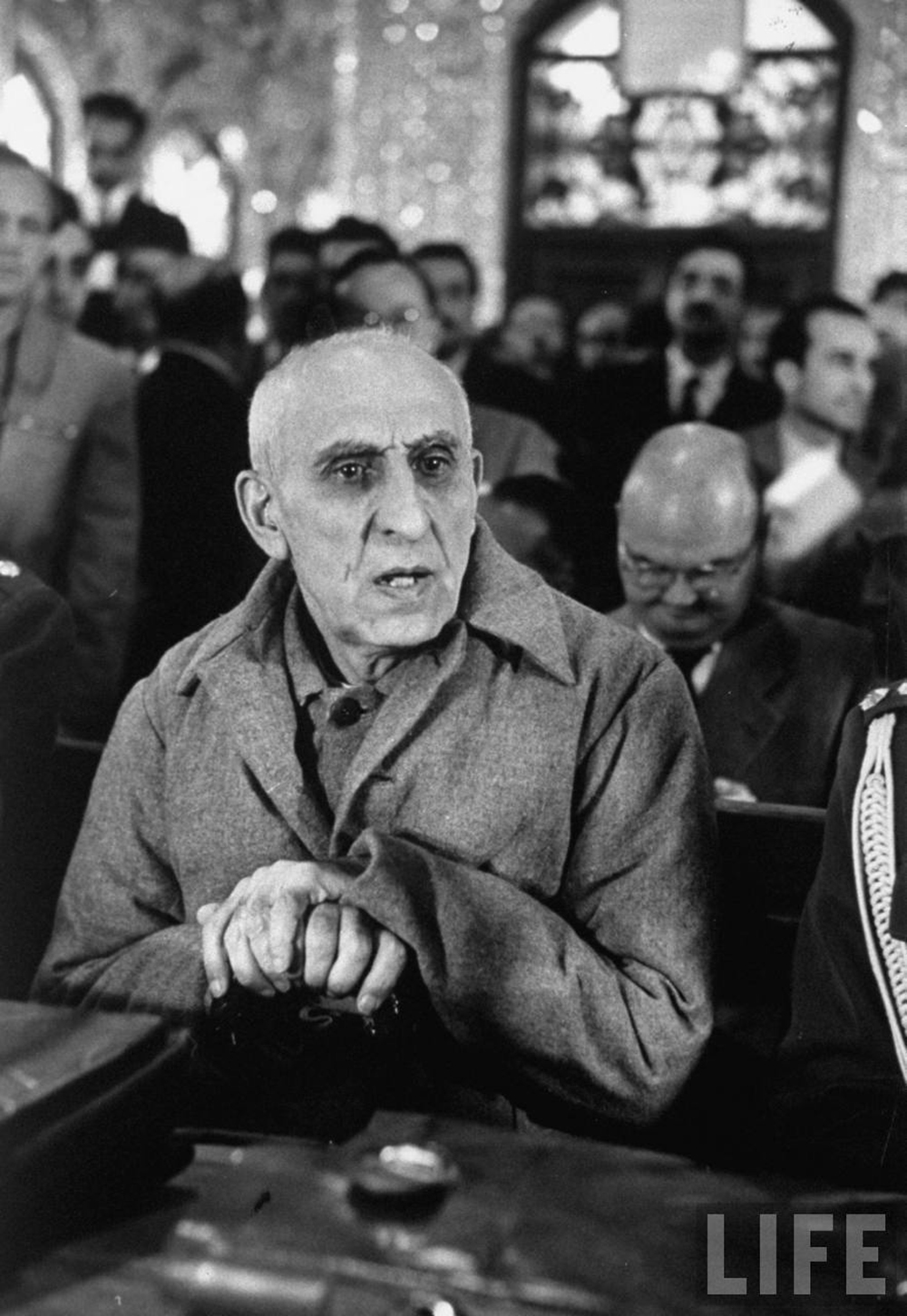 Mohamed Mossadegh, sitting in court, 1953. Photograph by Carl Mydans / Life Magazine.