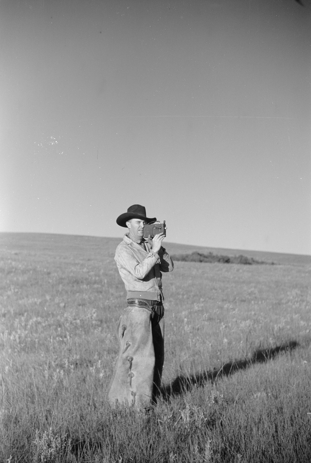 Cowboy with amateur movie camera in Montana, 1939. Photograph by Arthur Rothstein. Library of Congress, Prints and Photographs Division.