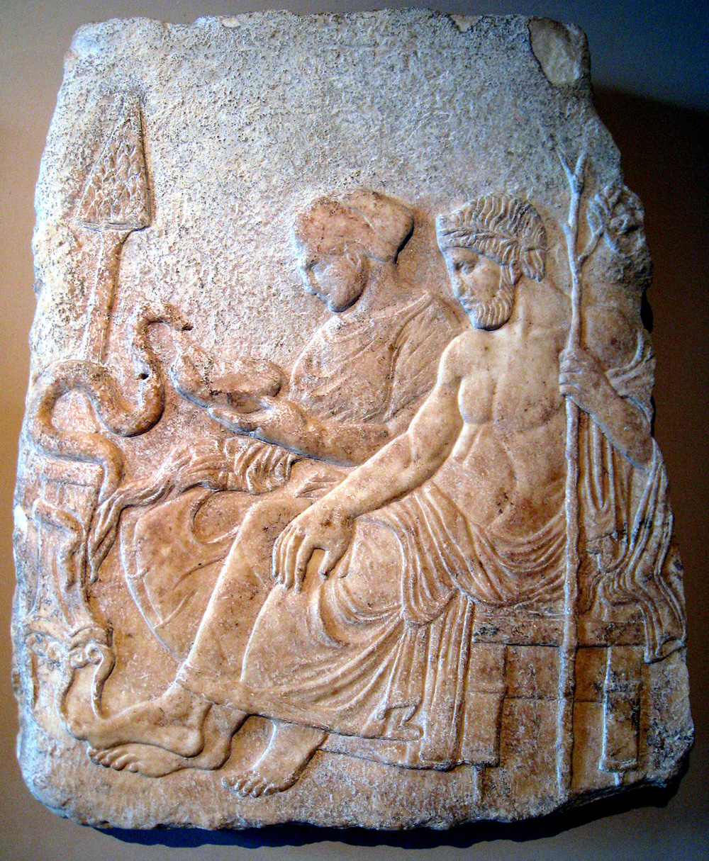 Marble relief of Asclepius, the god of medicine, and his daughter Hygieia, the goddess of cleanliness, c. 400 BC. The cult of Asclepius rose in prominence after the Athenian plague. Photograph by Prioryman. Wikimedia Commons, Istanbul Archaeological Museums.