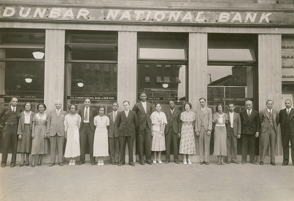 Photograph of the staff of the Dunbar National Bank in Harlem, c. 1930. Schomburg Center for Research in Black Culture, Photographs and Prints Division.
