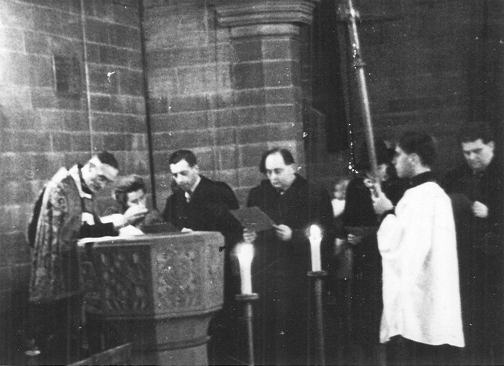 The author's christening in Liverpool, 1944. H. P. Smolka, then known as H. P. Smollett, is in the center.