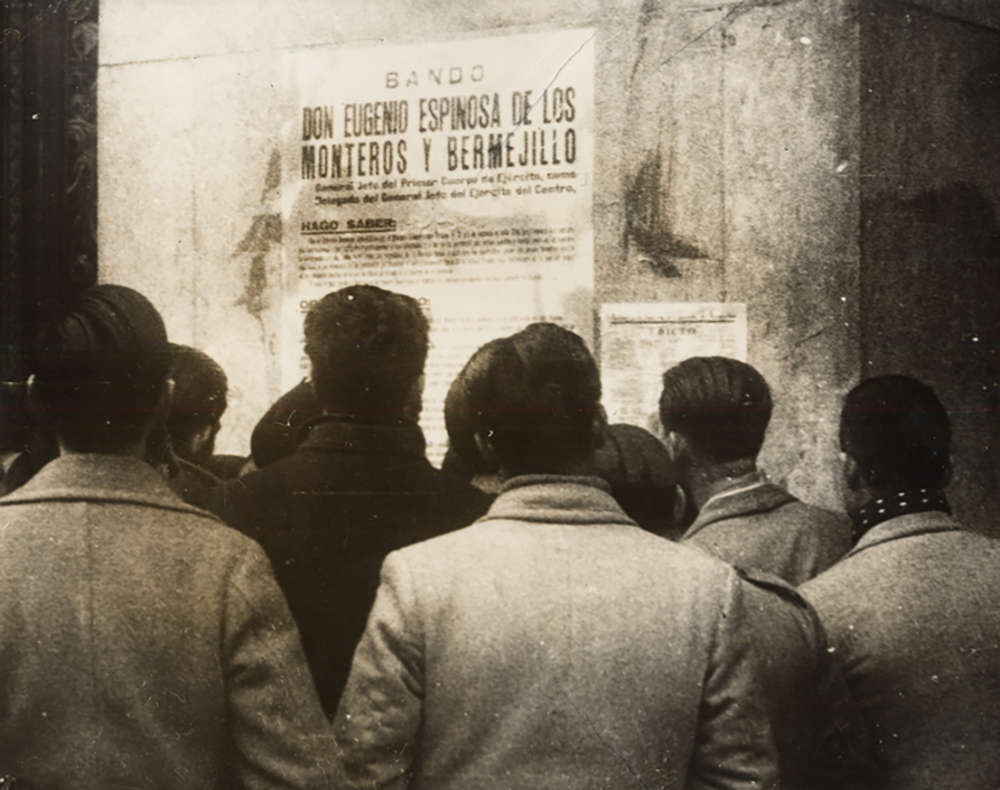 Residents of Madrid reading a Nationalist proclamation put up by General Franco's staff following the end of the Spanish Civil War, 1939. UC San Diego, Special Collections and Archives.