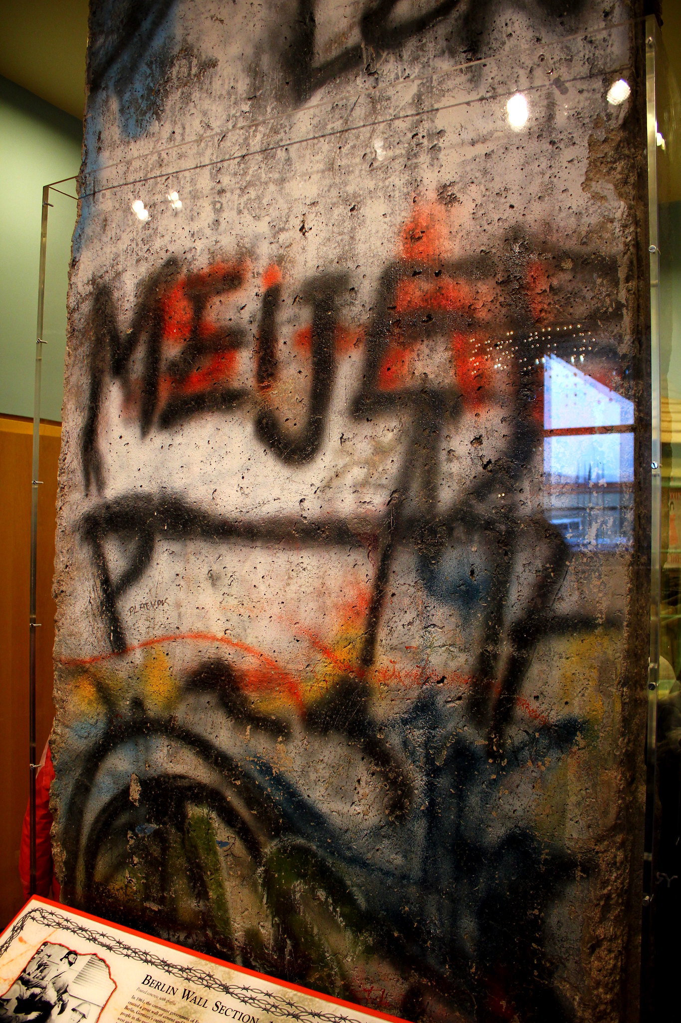 A segment of the Berlin Wall in a museum display with the word Meijer on it.