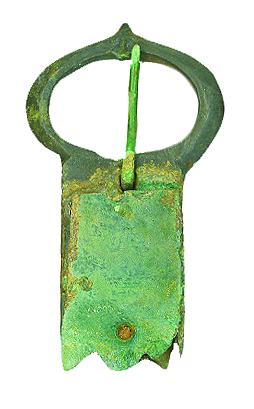 A green tarnished belt buckle.