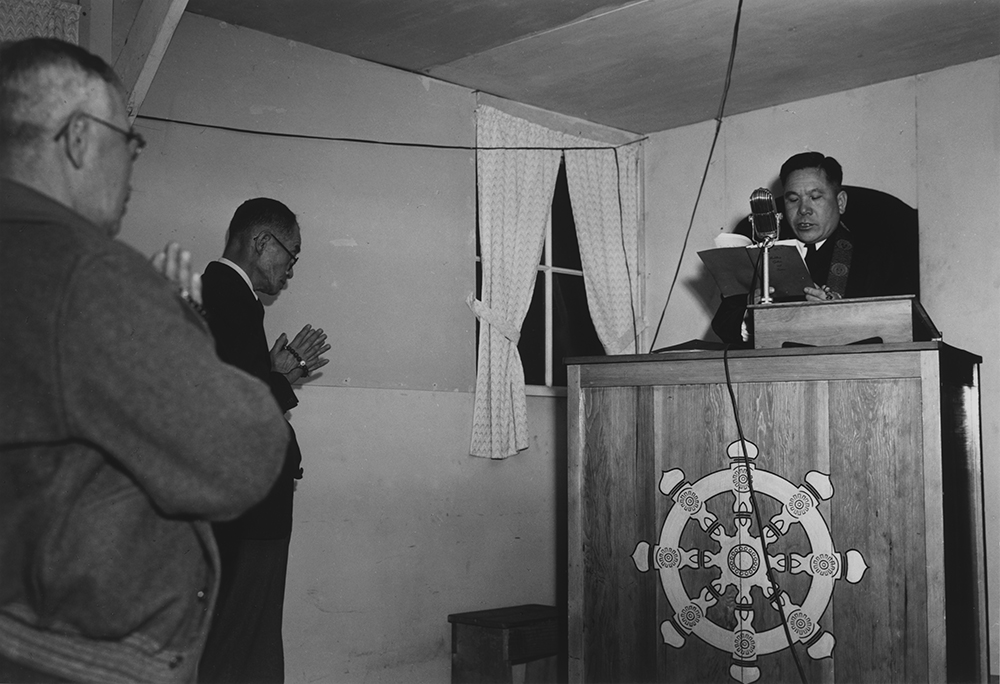 Buddhist service, Manzanar Relocation Center, California, 1943. Photograph by Ansel Adams. Library of Congress, Prints and Photographs Division.