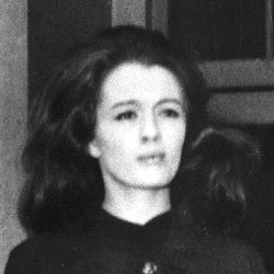 A black and white photograph of Christine Keeler.