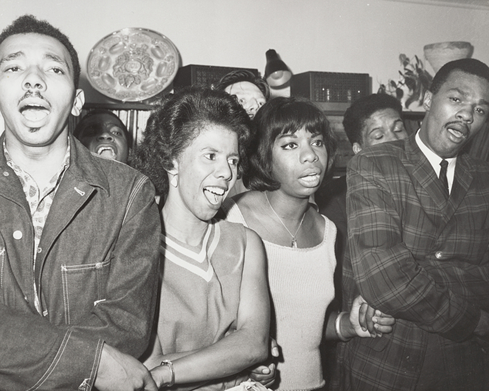 Singing in small group with Lorraine Hansberry and Nina Simone, 1963. The New York Public Library, Ivan Black papers.