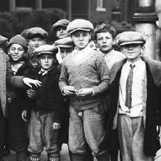 A black and white photo of a group of young boys.