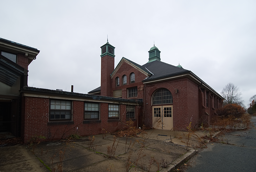 The Fernald's schoolhouse, 2016. This building was among the first constructed during the 1890s and included a full gymnasium for physical education. Photograph by David Whitemyer.