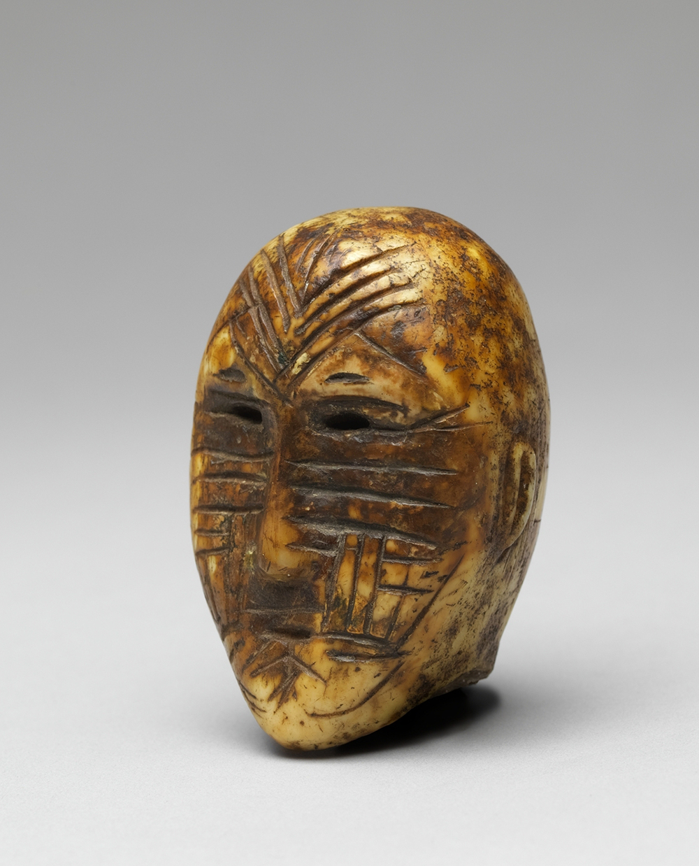 Head, Old Bering Sea, second to fourth century. The Metropolitan Museum of Art, Gift of Dorothy Elowitch, 1991.