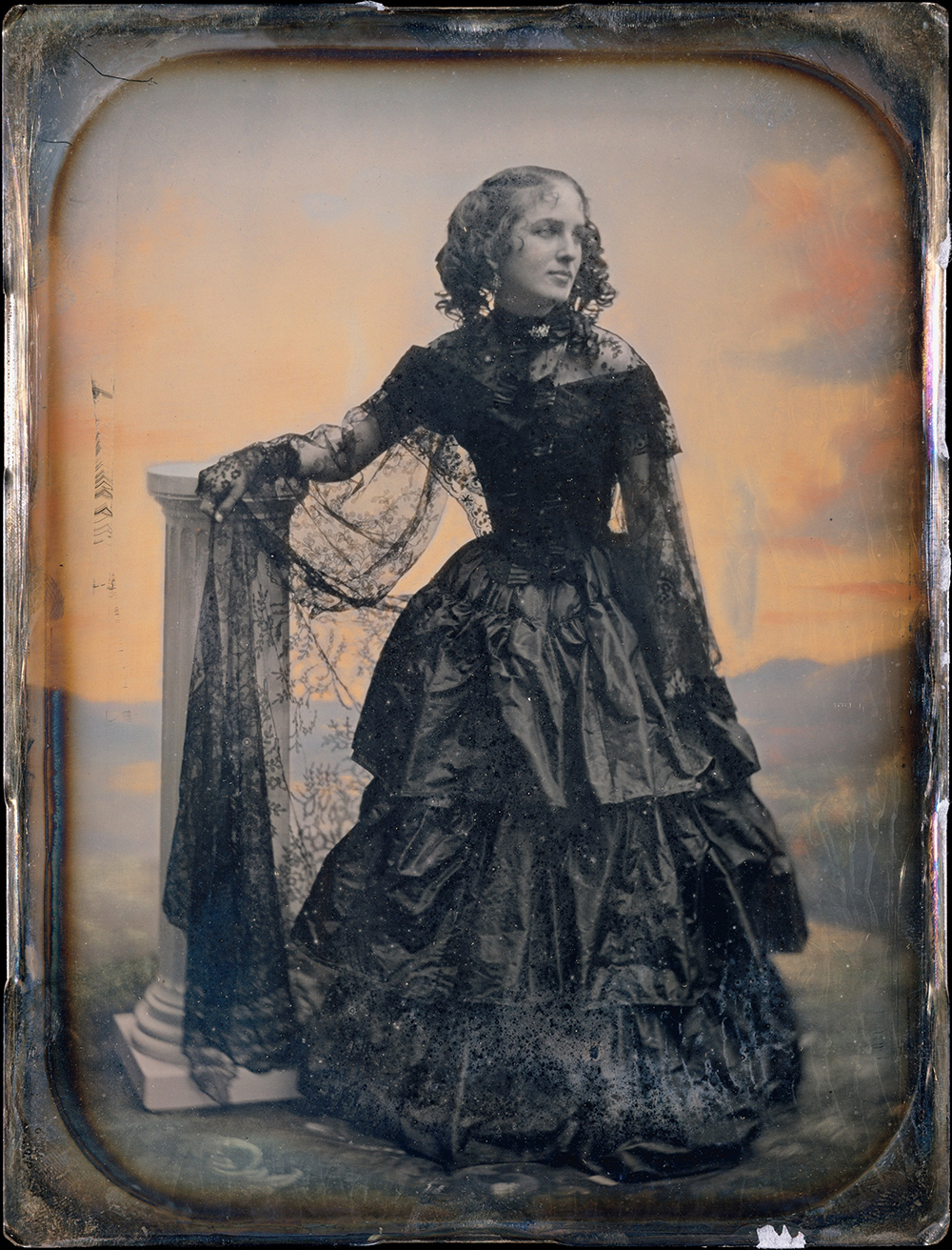 Photograph of woman in black taffeta dress and lace shawl by Southworth and Hawes, c. 1850.