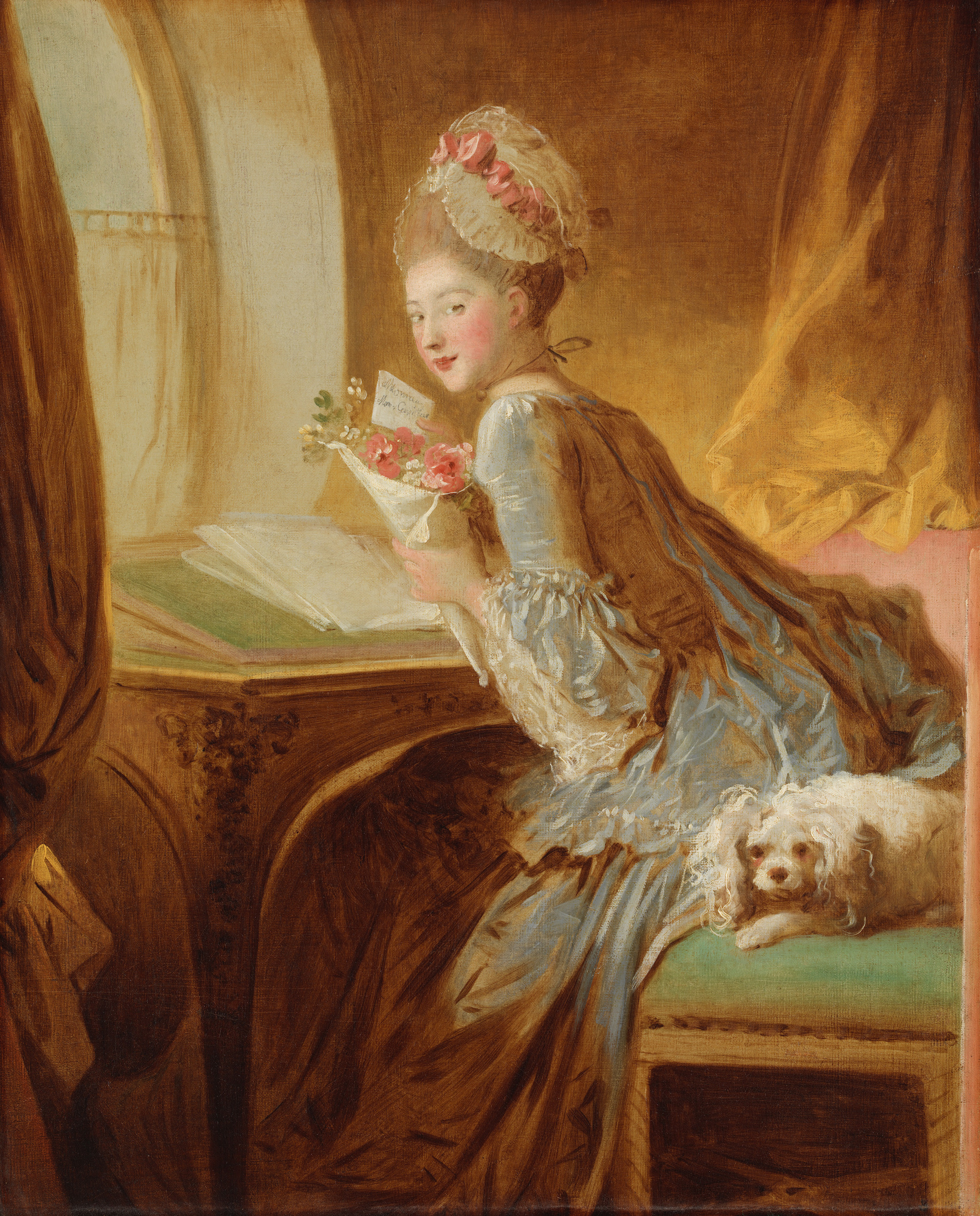 A woman wearing a blue dress and a tall white wig leans over a writing desk holding a letter and flowers. She looks back over her shoulder at the viewer. A small dog sits behind her on her chair. The light from the window above her desk gives the whole painting a warm yellow glow.