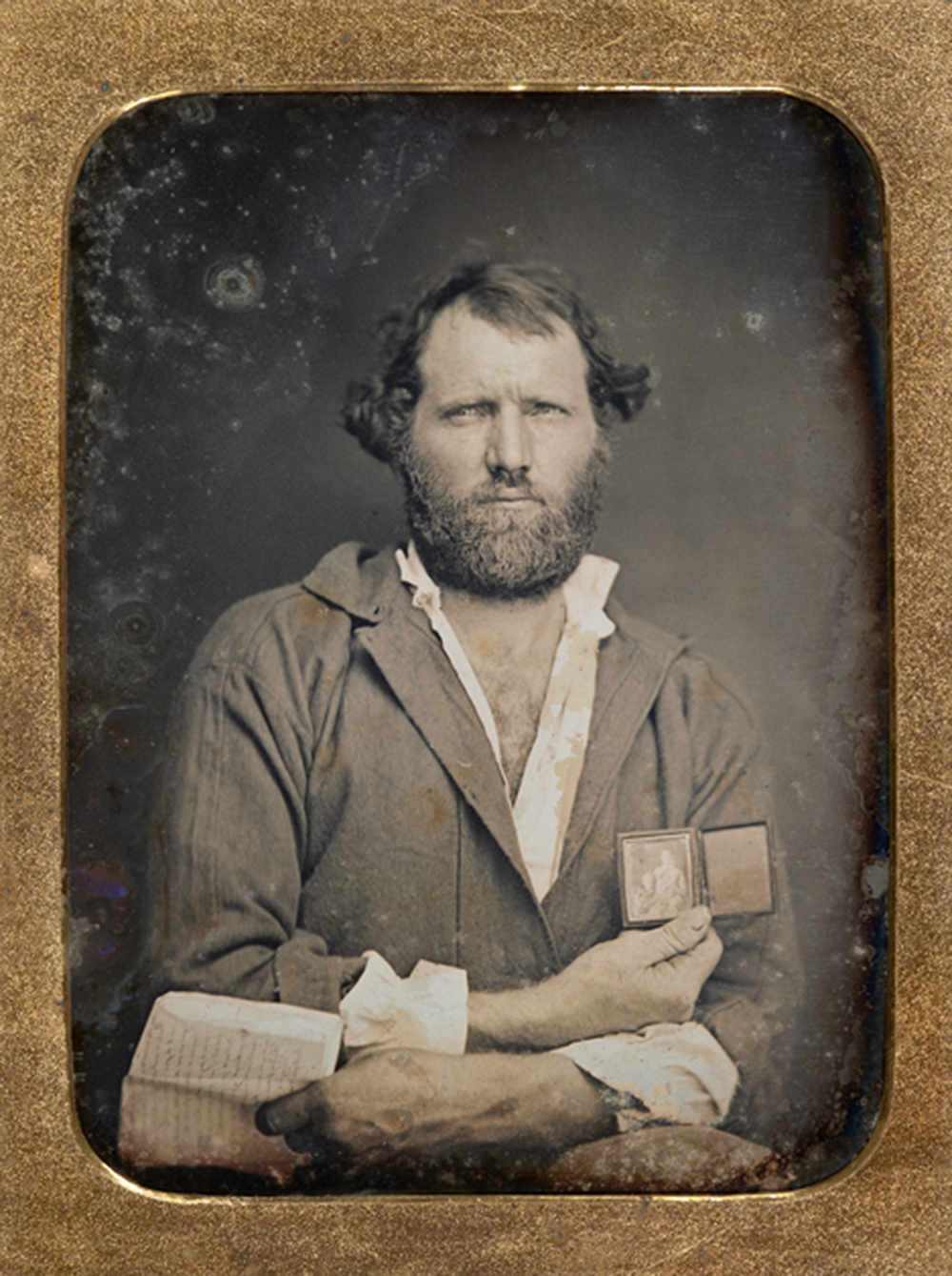 Portrait of a California gold miner with daguerreotype and letter, quarter-plate daguerreotype. c. 1852. The Nelson-Atkins Museum of Art.