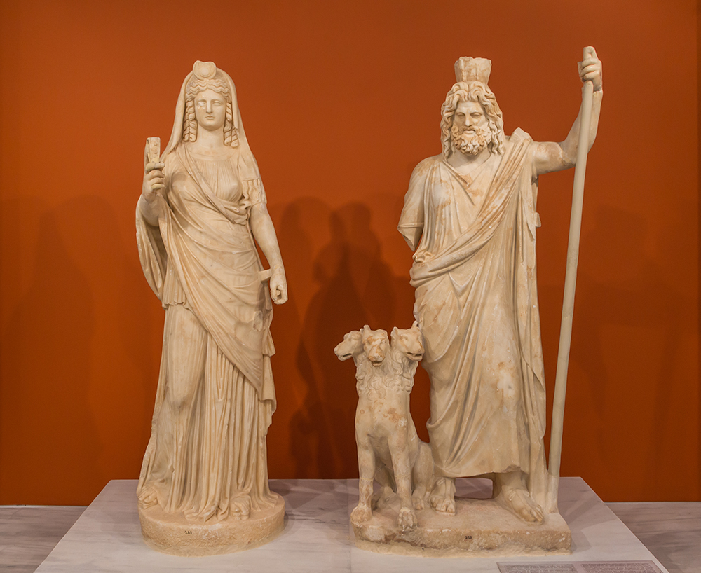Group of ancient Roman statues of Persephone (as Isis), Cerberus, and Pluto (as Serapis). Wikimedia Commons, Archaeological Museum of Heraklion.