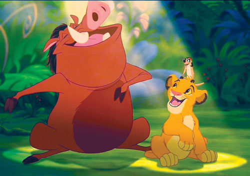 A still from Disney's animated movie The Lion King, depicting three characters, Timon (a meerkat), Pumba (a warthog), and Simba (a lion cub) singing under a spotlit in the jungle.
