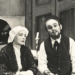 A black-and-white photograph of Harry Boens seated next to a woman