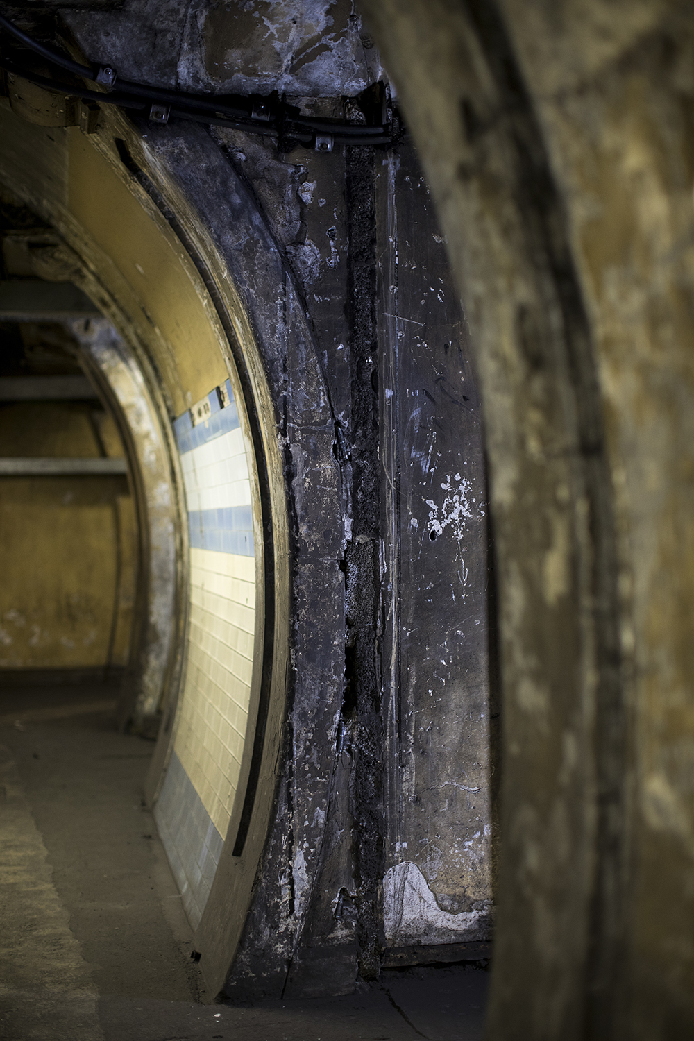 Extensive surviving witness marks in the wartime bunker conversion of the disused elevator shafts of Dover Street station (now Green Park). Marks like these were corroborated with surviving plans and helped to determine the layout of a similar conversion at Down Street for which plans no longer exist. Photograph by Toby Madden and Andy Davis.