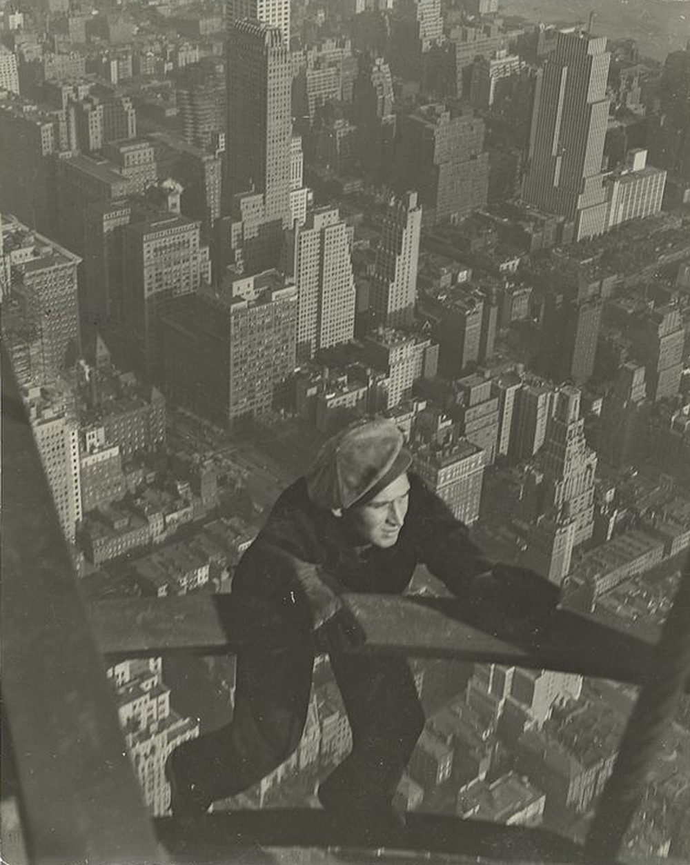 A worker hanging on to two steel beams, c. 1930. Photograph by Lewis Wickes Hine. New York Public Library, The Miriam and Ira D. Wallach Division of Art, Prints and Photographs.