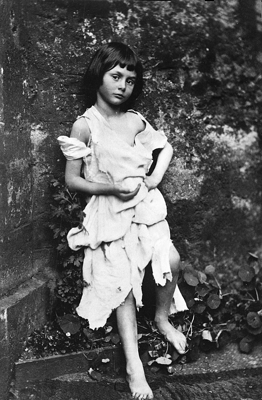 "Alice Liddell as ""The Beggar Maid,"" c. 1859. Photograph by Lewis Carroll."
