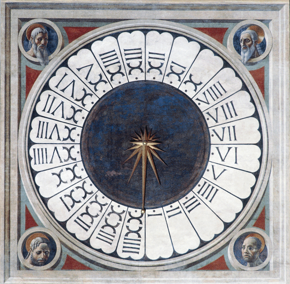 Clock with the heads of four prophets