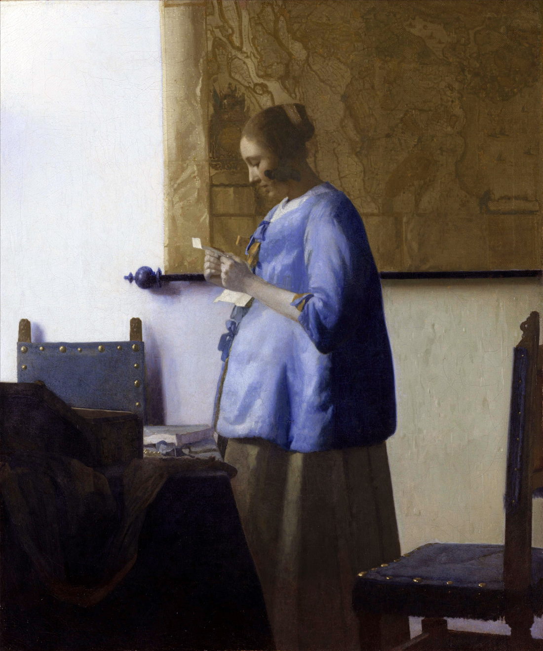 Woman in Blue Reading a Letter, by Jan Vermeer, c. 1662–1665. Rijksmuseum, Amsterdam, Netherlands.