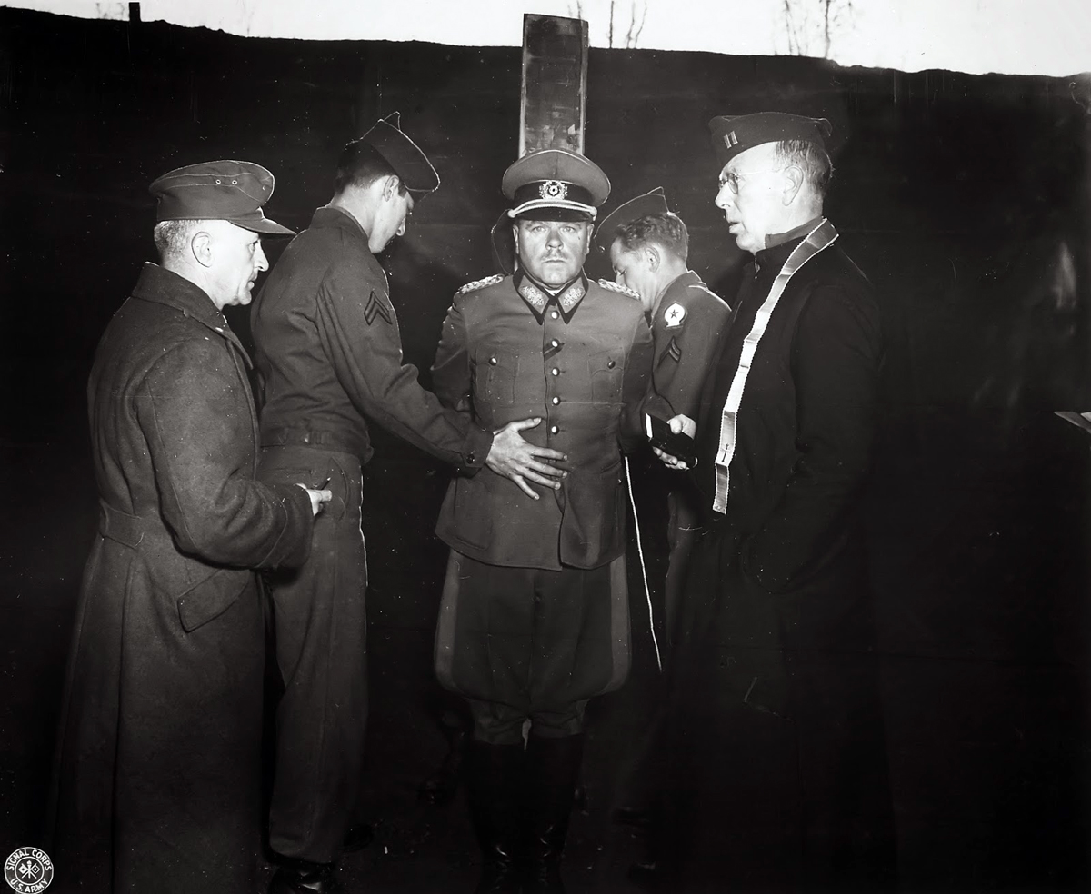 German General Anton Dostler receives last rites before his execution by firing squad. He was convicted and sentenced to death by an American military tribunal in Aversa, Italy, December 1, 1945. The U.S. National Archives and Records Administration, Coll