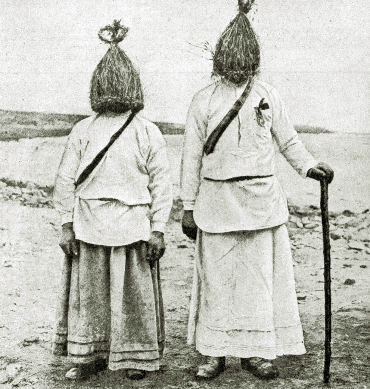 "Men dressed in traditional ""straw boy"" costumes, Ireland, 1922."