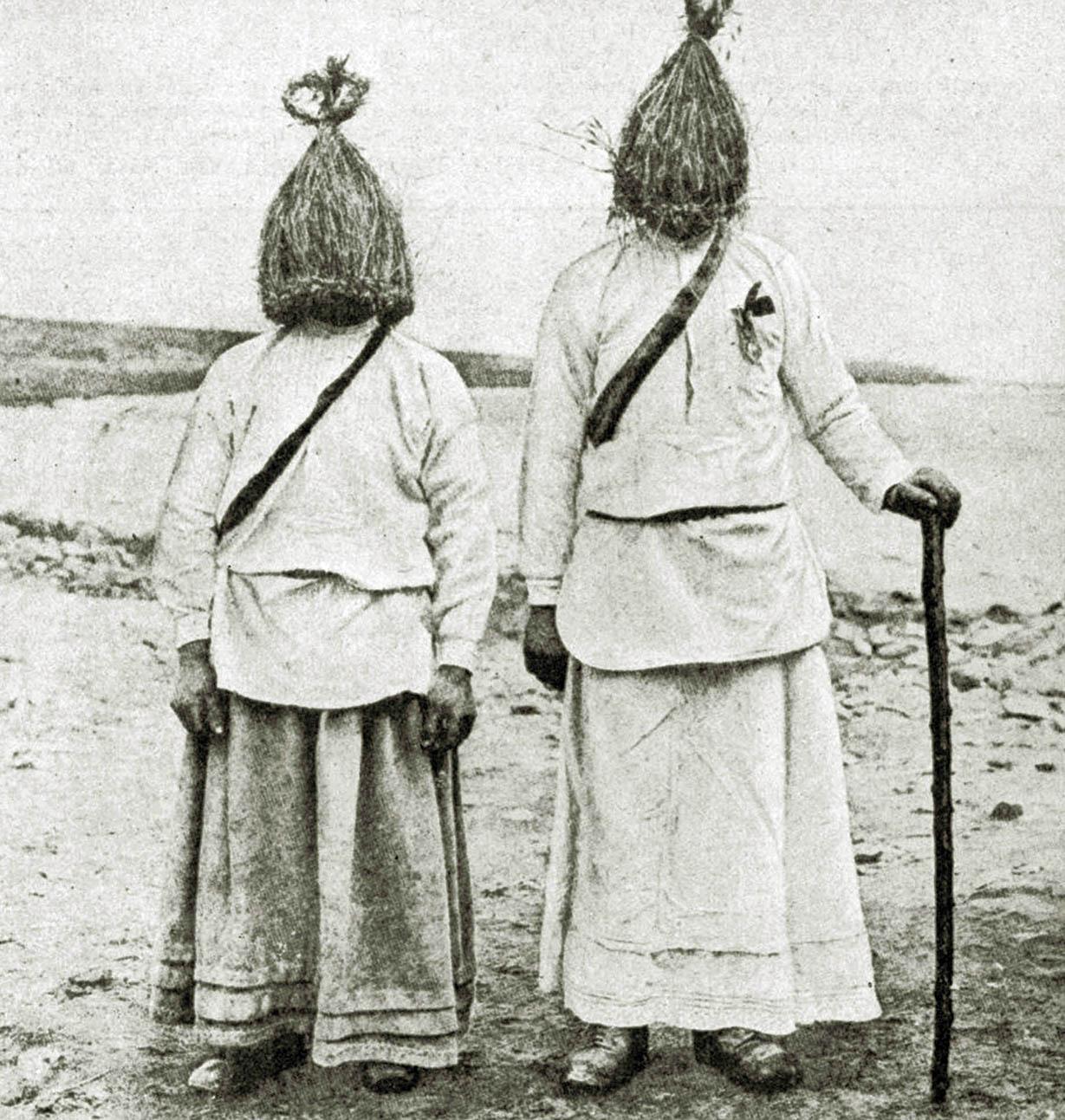 "Men dressed in traditional ""straw boy"" costumes, Ireland, 1922."