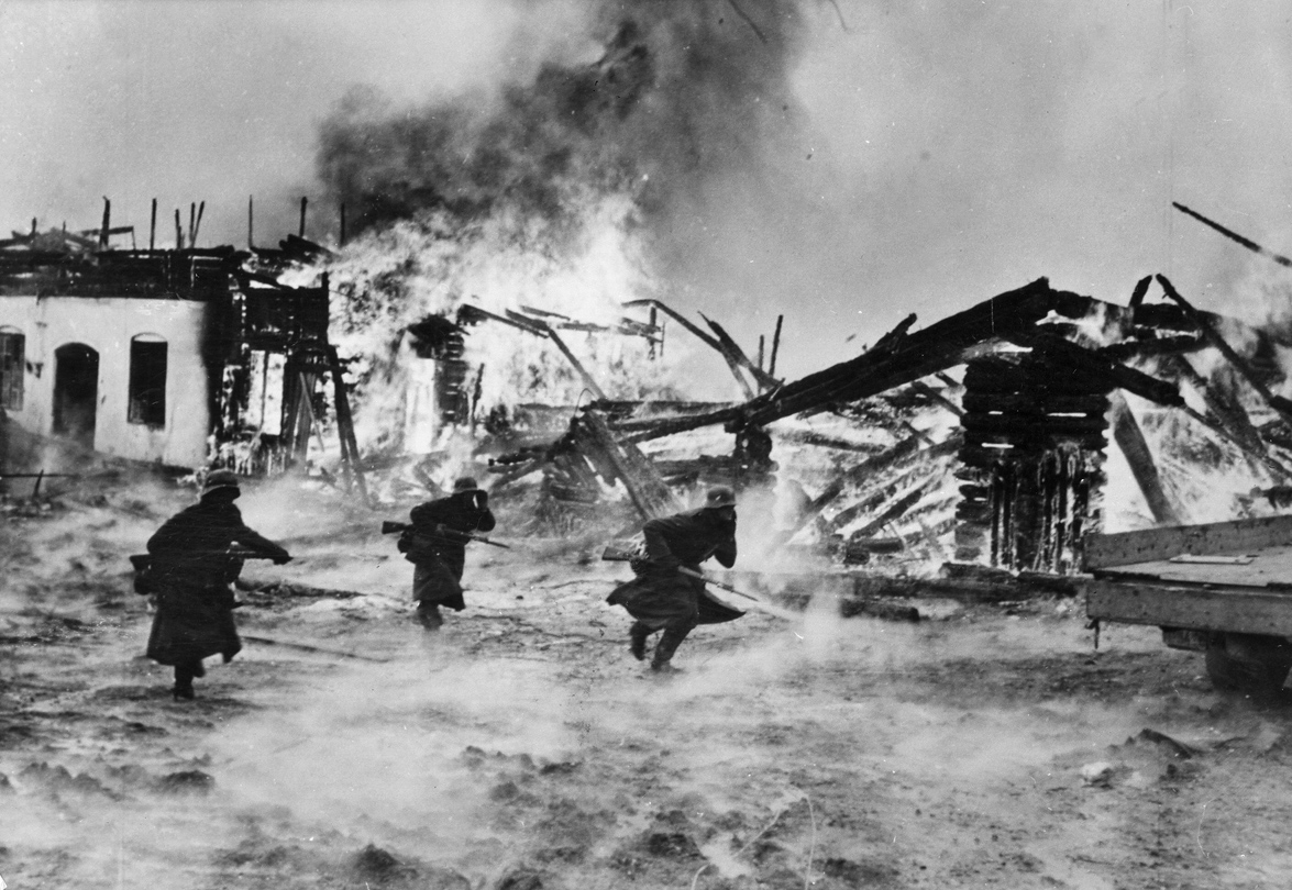 """Norway, Battle for a Burning Village,"" German Wehrmacht in Haugsbygd, Norway, 1940. Photography by Erich Borchert. German Federal Archives."
