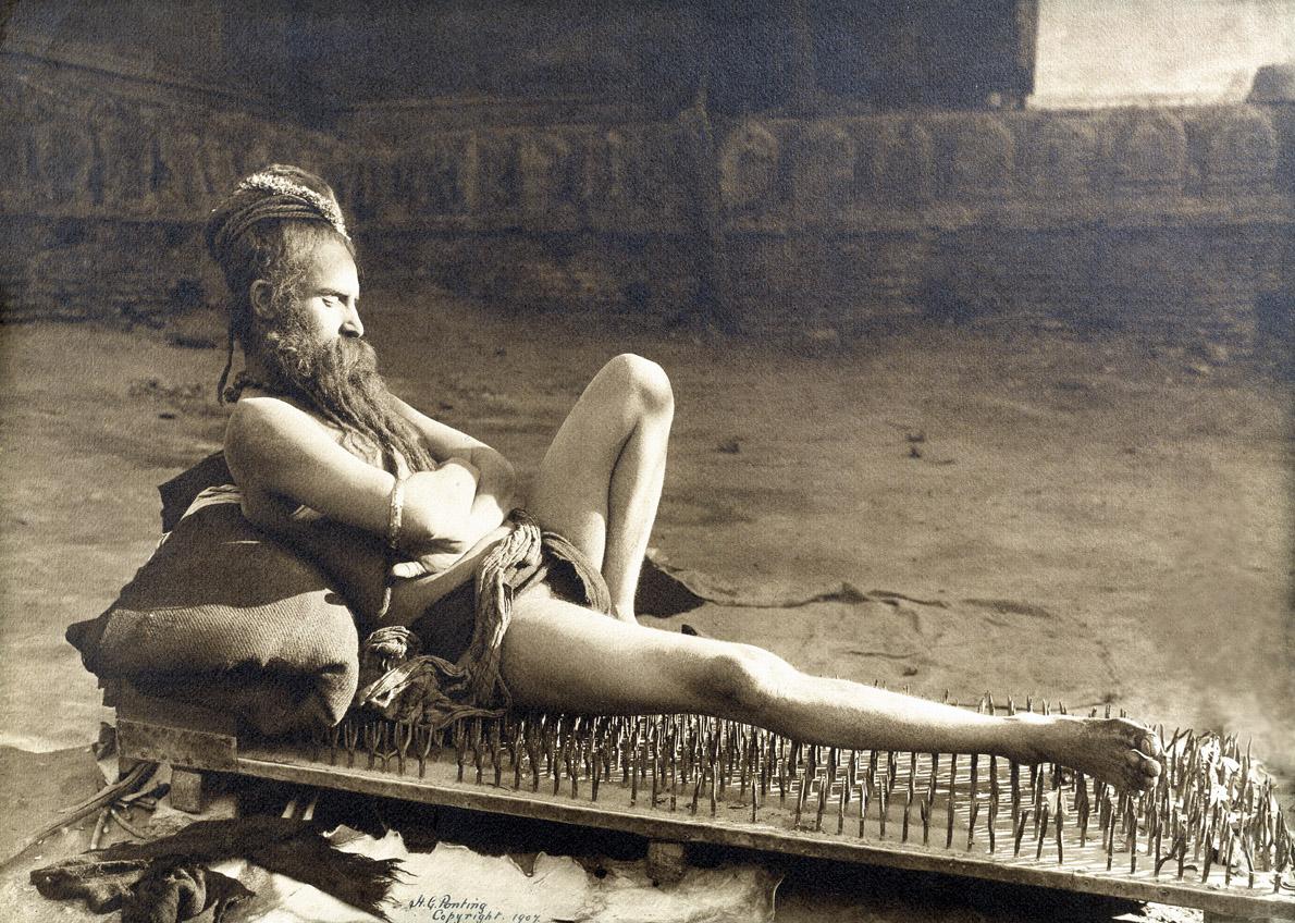 Fakir on a bed of nails, Varanasi, India, 1907. Photograph by Herbert Ponting.