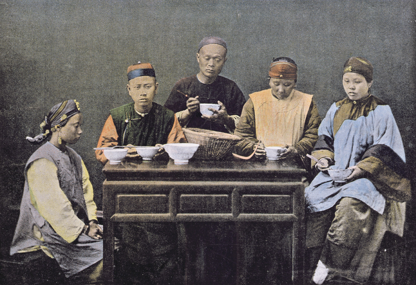 Family having a meal, China, c. 1900