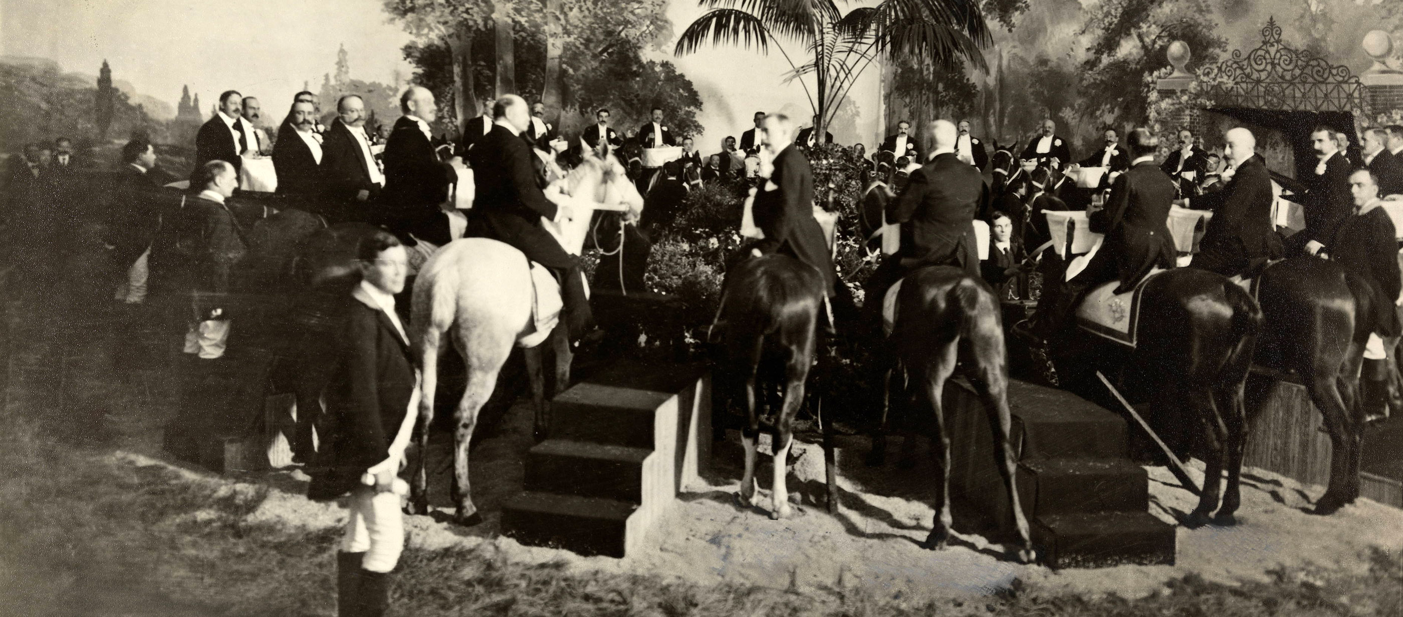 Dinner on horseback, hosted by industrialist C. K. G. Billings at the restaurant Sherry's, New York City, 1903. Each saddle was fitted with a tray and champagne bucket. The feast cost about $50,000.