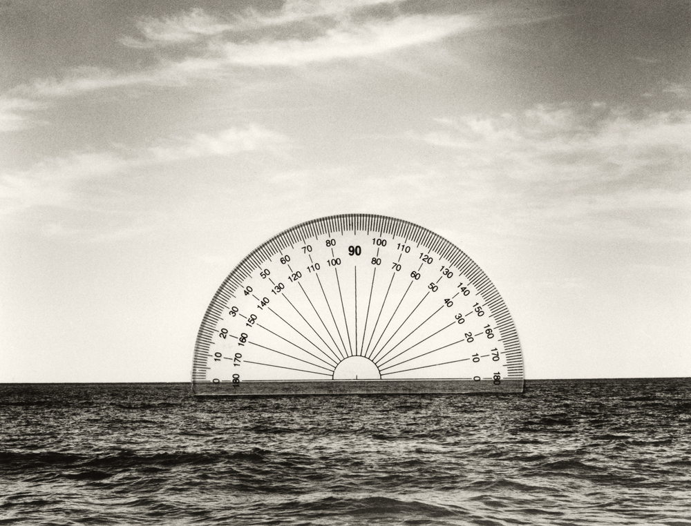 Contemporary art photograph showing a sextant above a seascape.