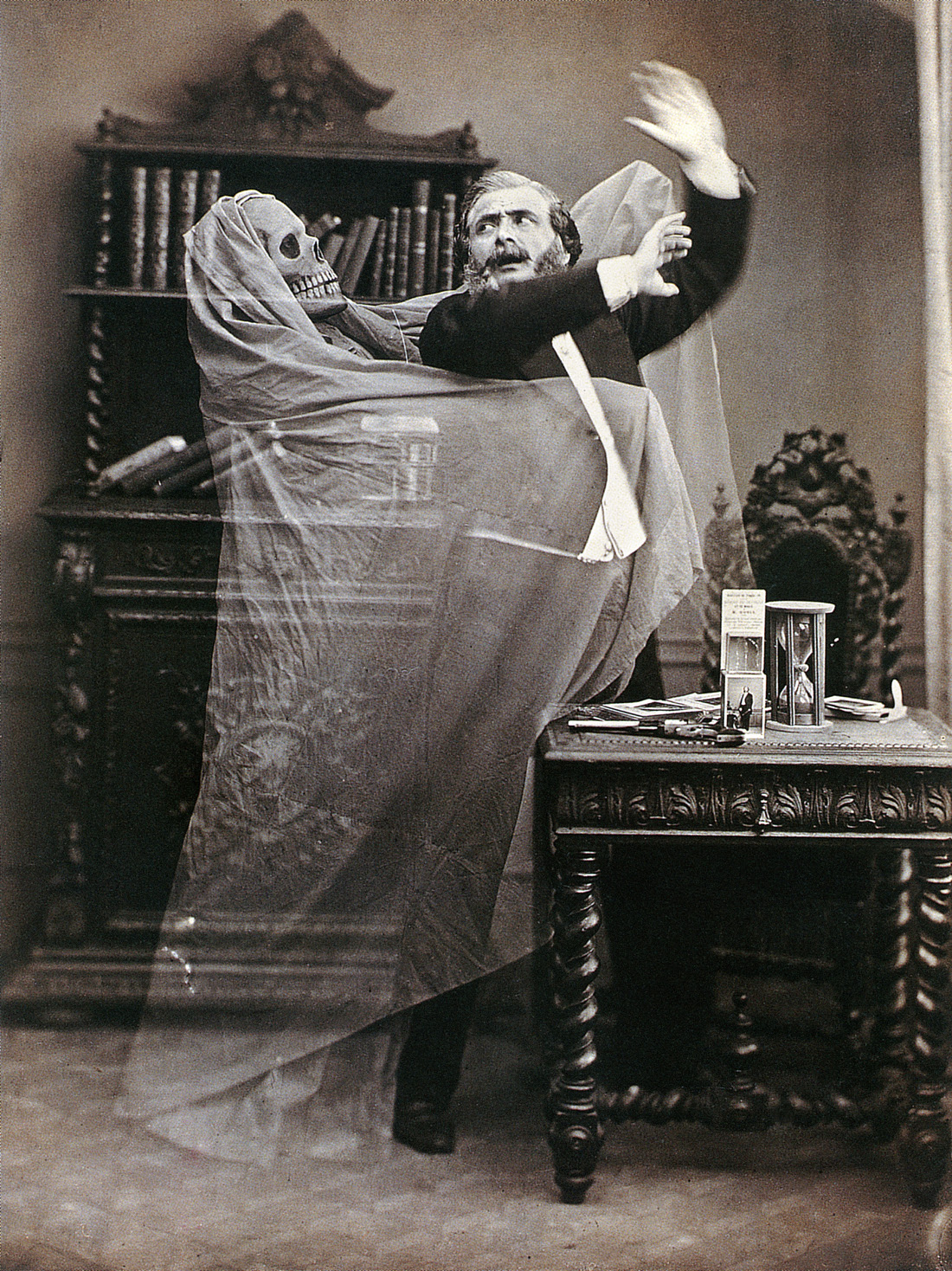 Double-exposed photograph of French illusionist Henri Robin with a ghost, by Eugène Thiébault, 1863. © The Granger Collection, NYC