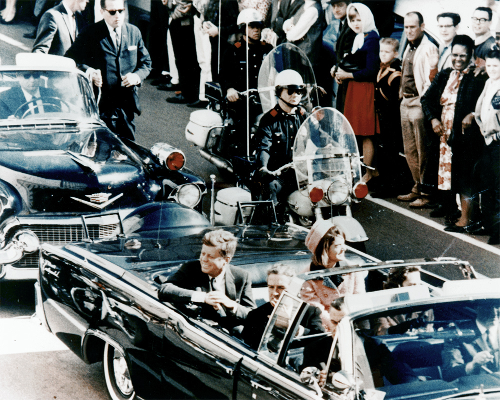 President John F.  Kennedy minutes before his assassination, Main Street, Dallas, Texas, 1963. Photograph by Walt Cisco.