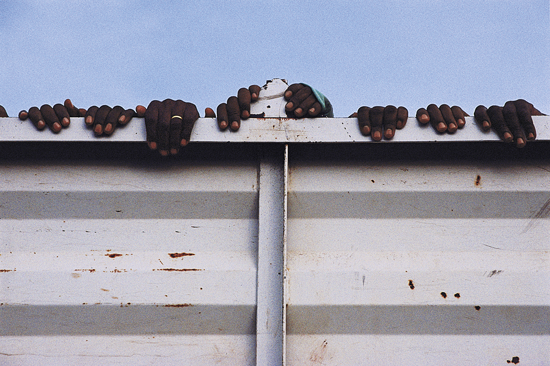Prisoners Trucked to Gacaca Hearing, from the series Rwanda: After, by Michael Ronnen Safdie, 2003.