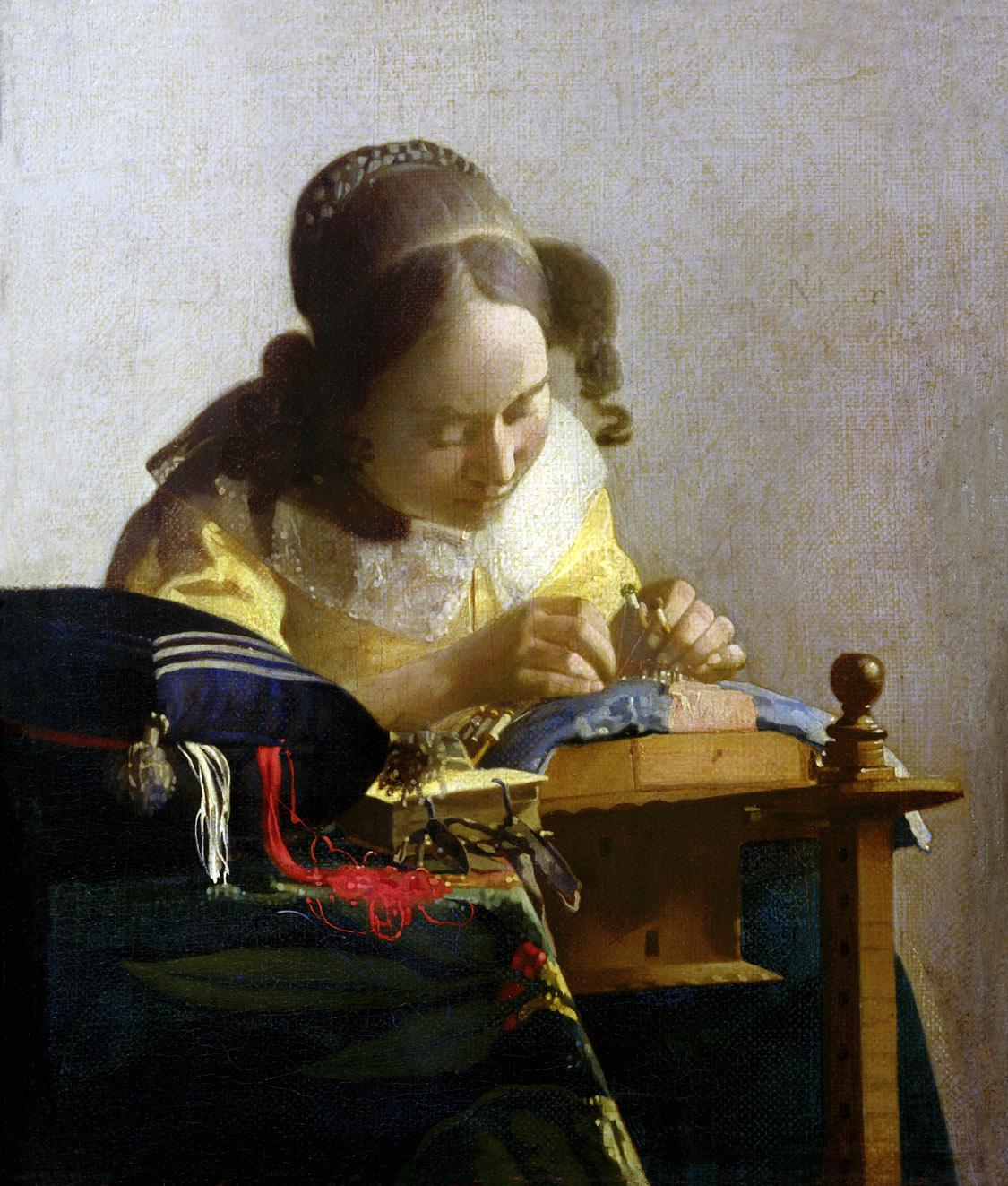 The Lacemaker, by Jan Vermeer, c. 1669. Louvre Museum, Paris.