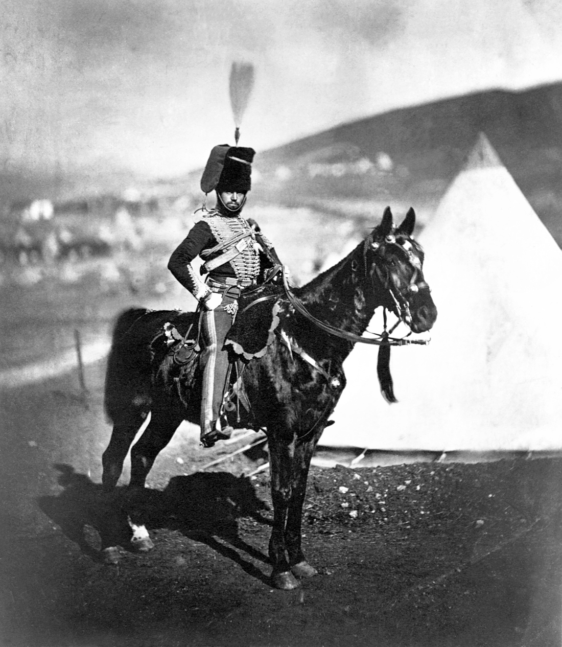 Cornet Wilkin of the 11th Hussars at camp in the Crimean War, 1855. Photograph by Roger Fenton. United States Library of Congress Prints and Photographs division, Washington D.C.