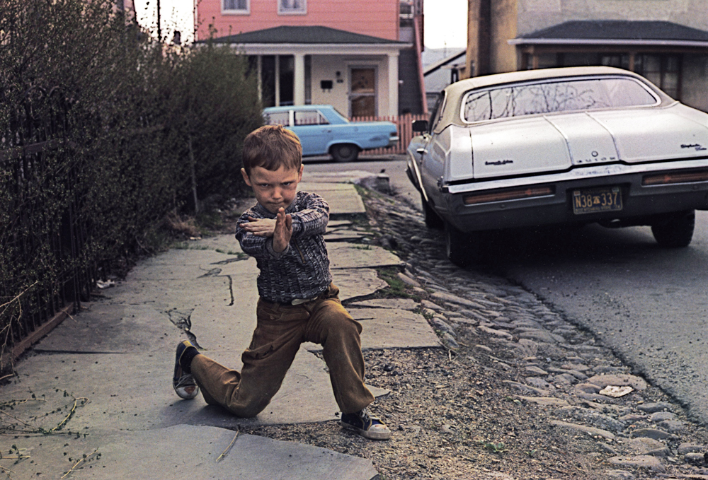 1977 color photograph of a young boy in a karate pose.