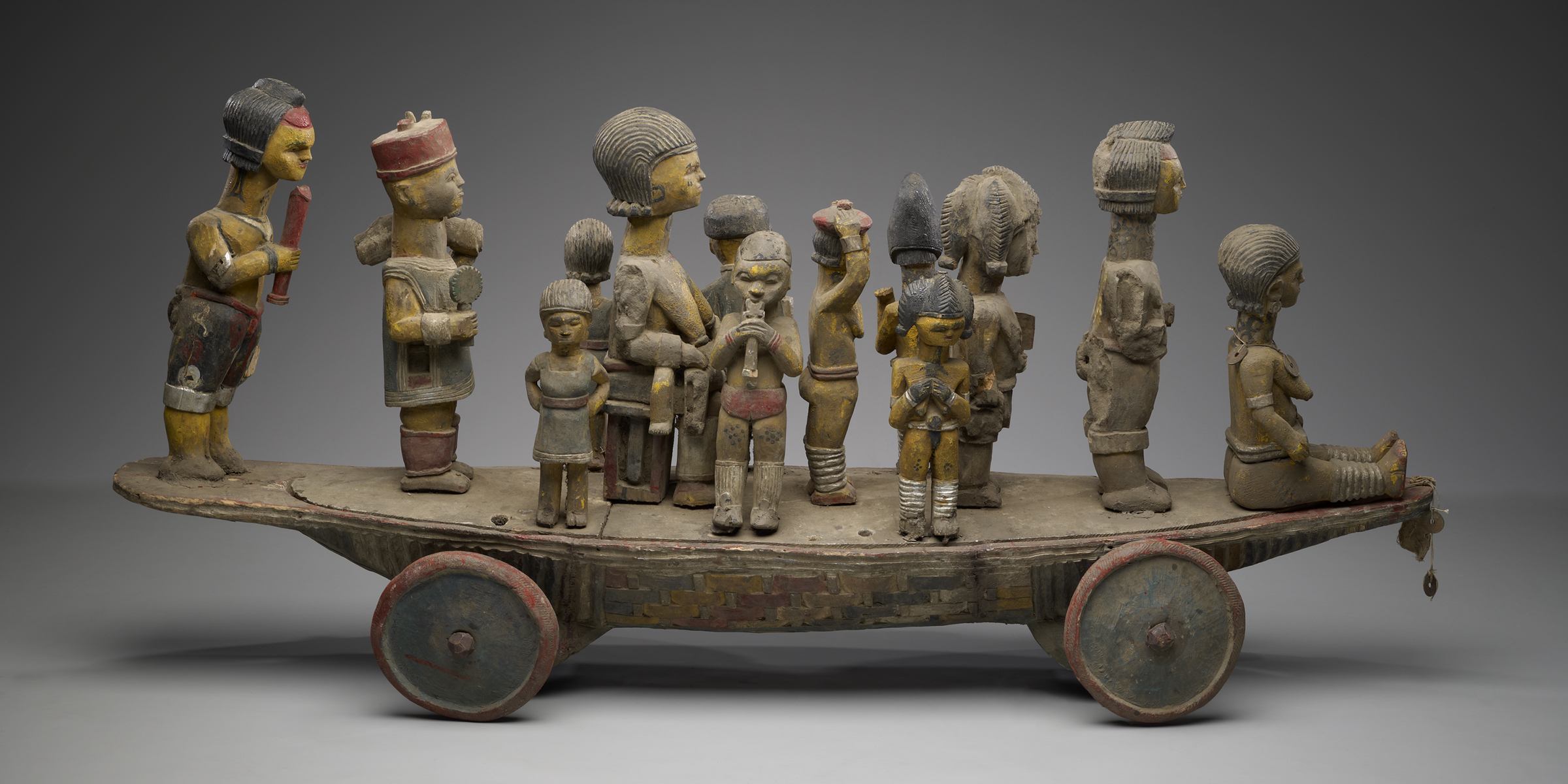 Boat on wheels supporting a queen and her entourage, Nigeria, twentieth century.