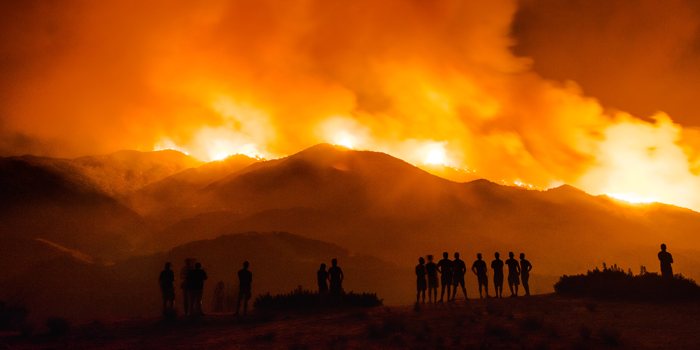 La Tuna Canyon Fire, by Kevin Cooley, 2017. Archival pigment print, 30 x 38½ and 40 x 51½ inches. A crowd gathers in the Los Angeles neighborhood of Tujunga to watch the La Tuna Canyon fire burn in the Verdugo Mountains north of Burbank. © Kevin Cooley, c