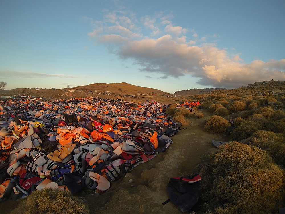 "Division Line, by Pam Longobardi, 2016. Archival pigment print, 27 x 40 inches. Site photograph of the ""life-jacket graveyard,"" Lesbos, Greece. © Pam Longobardi, courtesy the artist and HATHAWAY 