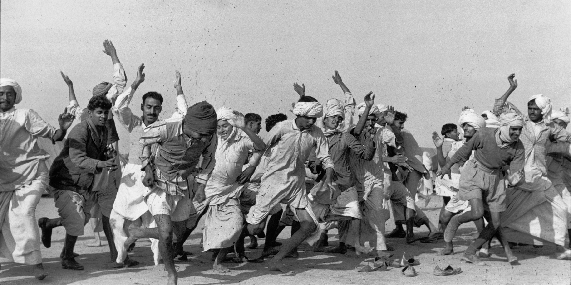 Refugees exercising to drive away lethargy and despair, Kurukshetra, India, 1947. Photograph by Henri Cartier-Bresson. © Henri Cartier-Bresson/Magnum Photos.