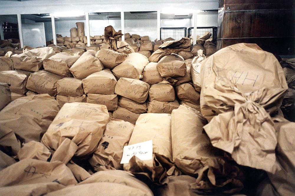 Sacks full of Stasi files in the former Ministry for State Security headquarters, Berlin, 1996. © SZ Photo/Joker/David Ausserhofer/Bridgeman Images.